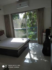 Gallery Cover Image of 850 Sq.ft 2 BHK Apartment for rent in Juhu for 100000
