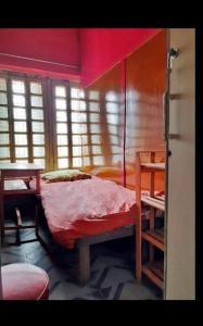 Bedroom Image of Sagnik PG in Kalighat