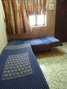 Bedroom Image of Agrawal PG in Govandi