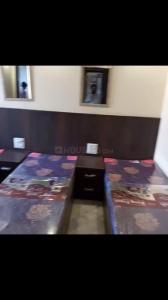 पटेल नगर में सलूजा पीजी के बेडरूम की तस्वीर