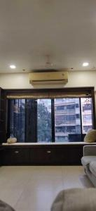 Gallery Cover Image of 900 Sq.ft 2 BHK Apartment for rent in Wood Rose Apartments Chsl, Andheri West for 60000