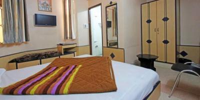 Bedroom Image of Hotel Tap Paradise in Gandhi Nagar