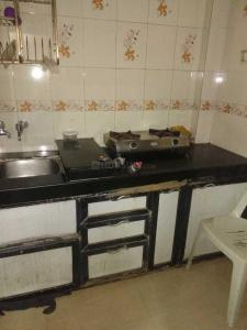 Gallery Cover Image of 200 Sq.ft 1 RK Apartment for rent in Malad West for 10500