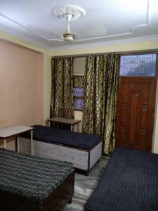 Bedroom Image of Gagan PG in South Extension I