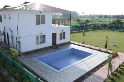 Gallery Cover Image of 900 Sq.ft 2 BHK Independent House for buy in Dkrrish Green Beauty Farms, Nagli Sabapur for 7837500