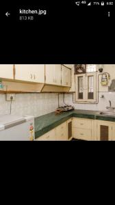 Kitchen Image of Anuranjan Nest in Sector 62