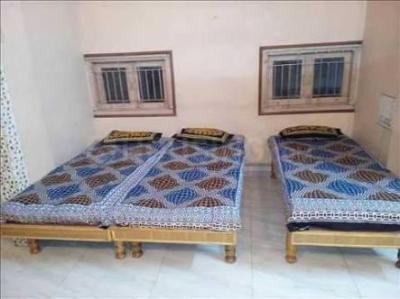 Bedroom Image of Shree Ganesh PG in Motera