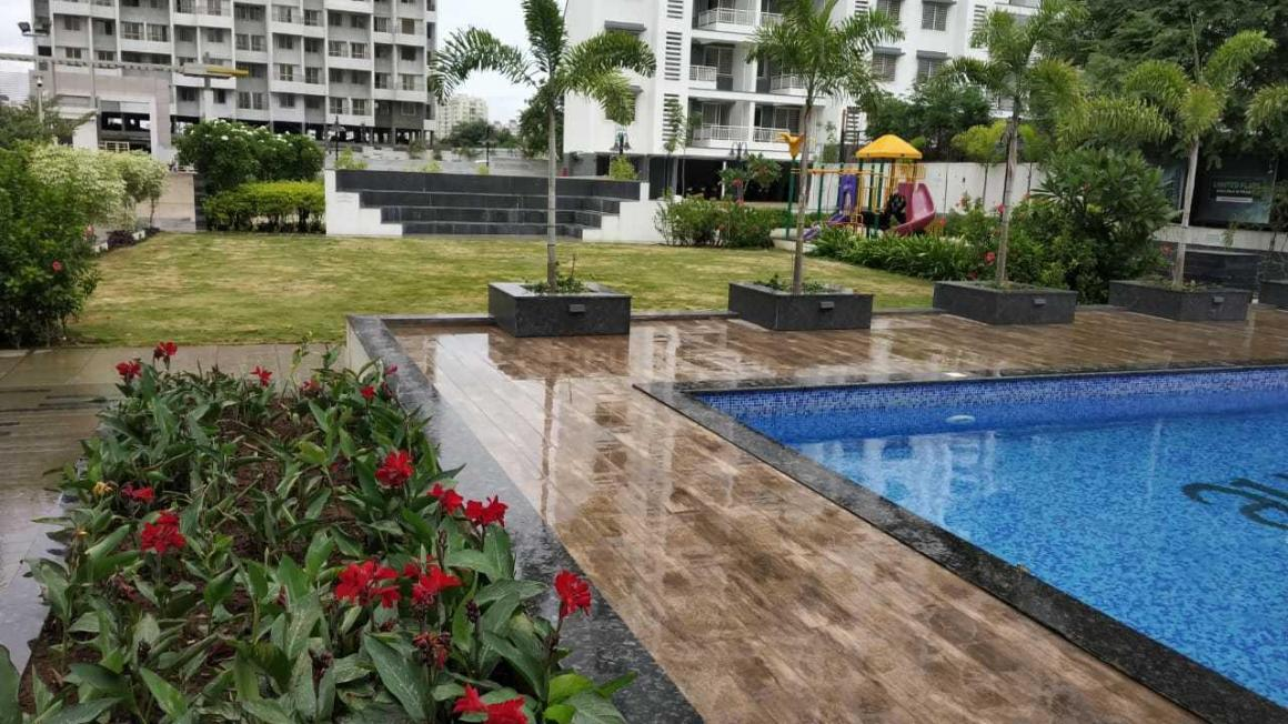 Garden Area Image of 1153 Sq.ft 3 BHK Apartment for buy in Moshi for 5050000