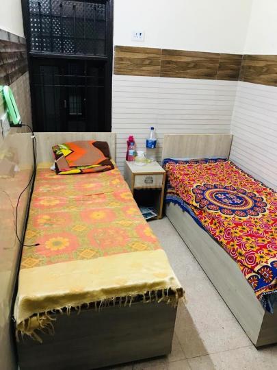गोविंदपुरी में अग्रवाल पीजी हाउस में बेडरूम की तस्वीर