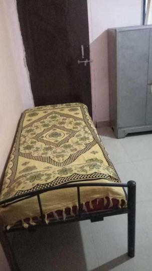खराड़ी में प्रतिभा पीजी के बेडरूम की तस्वीर