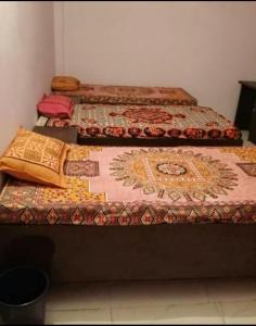 Bedroom Image of Pardeep PG in Chirag Dilli