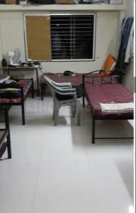 Bedroom Image of Kamal Boys Hostel in Narhe