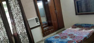 Bedroom Image of Komal PG in Rajouri Garden