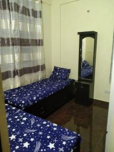Bedroom Image of Emerald Hi Tech PG in Vijayanagar