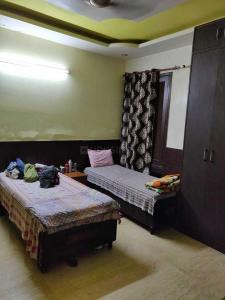 Bedroom Image of Guru Ji PG in Sector 28
