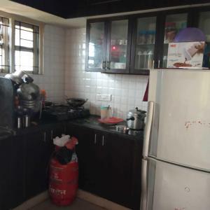 Kitchen Image of Aruna PG in Chikkajala