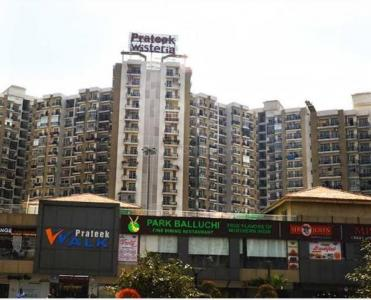 Gallery Cover Image of 1385 Sq.ft 3 BHK Apartment for buy in Prateek Wisteria, Sector 77 for 8200000