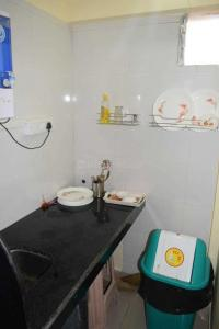 Kitchen Image of Vaiman PG in Andheri East