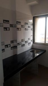 Gallery Cover Image of 609 Sq.ft 1 BHK Apartment for buy in Mansarovar Residency, Desai Village for 3800000