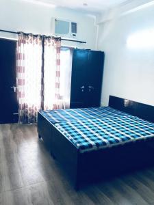 Bedroom Image of Shree Laxmi Accommodation in DLF Phase 5