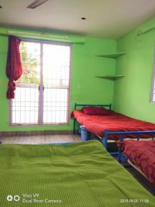 Bedroom Image of Rani Ladies Hostel in Sholinganallur