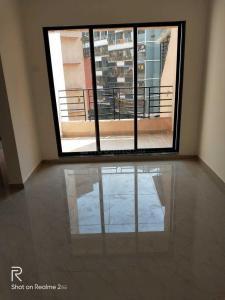 Gallery Cover Image of 685 Sq.ft 1 BHK Apartment for rent in Shreeji Virat Vastu, Ambivli for 7500