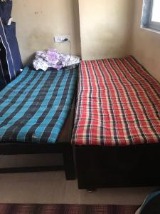 Bedroom Image of Shree Ram PG in Goregaon West