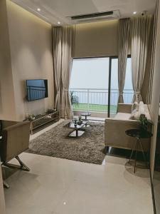 Gallery Cover Image of 700 Sq.ft 2 BHK Apartment for buy in Sunteck West World, Naigaon East for 4455000