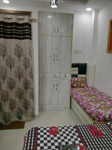 Bedroom Image of Stay 97 PG in Madangir