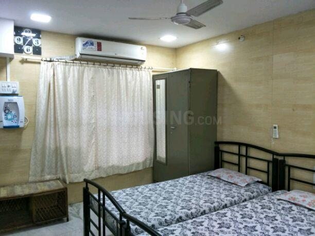 महपे में शिवम पीजी में बेडरूम की तस्वीर