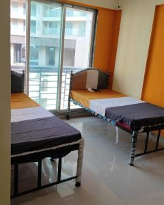 Bedroom Image of Oxotel Paying Guest In Kanjurmarg in Kanjurmarg West
