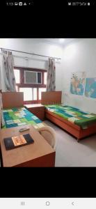 Bedroom Image of Girls PG In Malviya Y in Malviya Nagar
