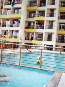 Gallery Cover Image of 620 Sq.ft 1 BHK Apartment for rent in Gami Amar Harmony, Taloje for 8500