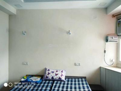 Bedroom Image of Arpit PG in Begumpur
