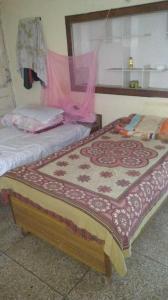 Bedroom Image of Harmeet Kaur PG in Vikaspuri