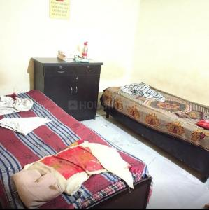 Bedroom Image of Sudesh PG in Govindpuri