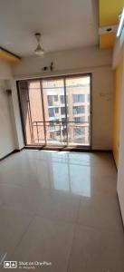 Gallery Cover Image of 685 Sq.ft 1 BHK Apartment for rent in Gemstar Sonata, Malad West for 23000