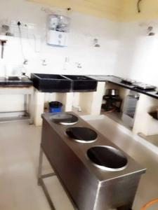 Kitchen Image of Sri Sai Luxurious PG in Sanjaynagar