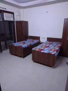 चेतना पीजी इन सेक्टर 45 के बेडरूम की तस्वीर