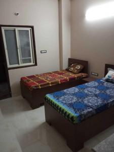 Bedroom Image of Guru Girls PG in Sector 49