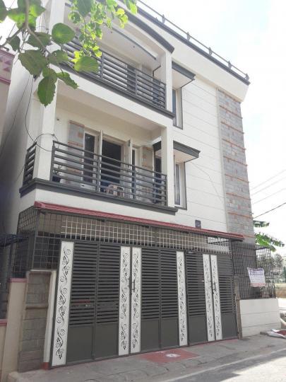 बिकासीपुरा में एसएनके लेडिज पीजी में बिल्डिंग की तस्वीर