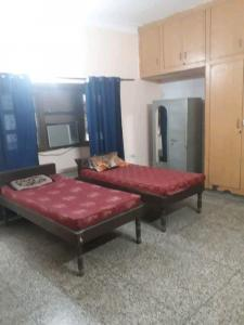 Bedroom Image of Nandini PG in Sector 23A