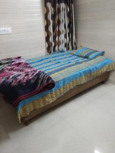 Bedroom Image of Guru Ji PG in Subhash Nagar