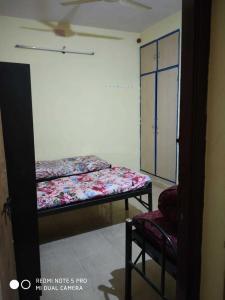 आर. टी. नगर में विलास पीजी में बेडरूम की तस्वीर