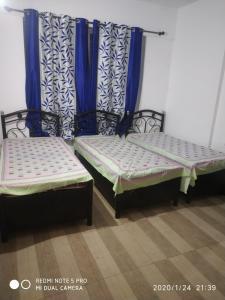 Bedroom Image of Nand PG in Maan