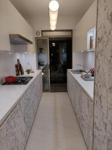 Gallery Cover Image of 790 Sq.ft 2 BHK Apartment for buy in Jogeshwari West for 18600000