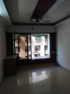 Gallery Cover Image of 650 Sq.ft 1 BHK Apartment for buy in Malad West for 9000000