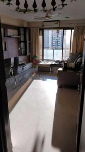 Gallery Cover Image of 1050 Sq.ft 2 BHK Apartment for rent in Prakriti Towers, Goregaon East for 45000