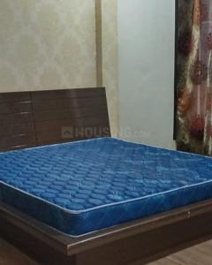 Bedroom Image of Happy Living PG in Sector 19