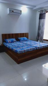 Bedroom Image of Girls PG Jmd Megapolis in Sector 48